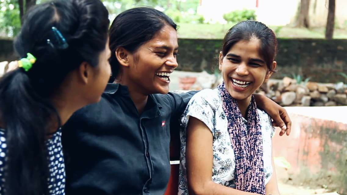 Sunita (middle) with her fellow delivery girls