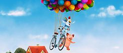 Film still: a pig, mouse and a chicken on a bike hanging on ballons