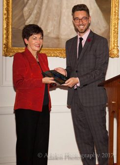 Translator Stefan Grand-Meyer presents the Governor-General of NZ, Dame Patsy Reddy, with a copy of the book
