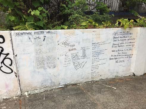 A poetry wall in Newtown where people can write down their poems and messages they'd like to share.