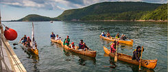 The Hōkūleʻa crew arrives in Somes Sound Maine where they are warmly greeted by the Penobscot people in their traditional birch bark canoes.