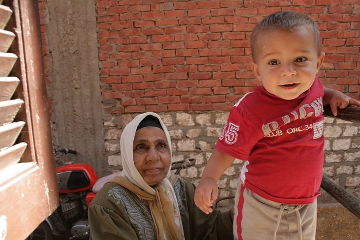 A grandmother with her grandson in Tizmant, Egypt