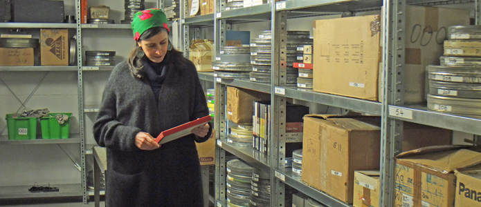 Shirin Barghnavard in the storage room of the Harun Farocki Institut in Berlin.