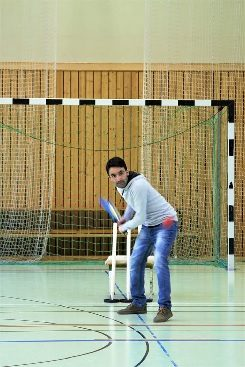 Cricket training on an indoor soccer pitch.