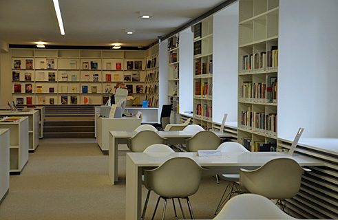 The library's collection of books and media can be used in the reading room by anyone interested.
