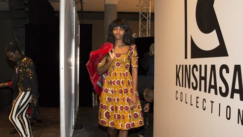 A model is preparing for the show that was organized by the South African fashion activist Goitseone Montsho.