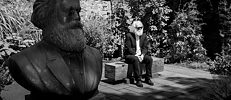Michael Thielen is Karl Marx double in Trier. He sits in the garden of the Karl Marx House.