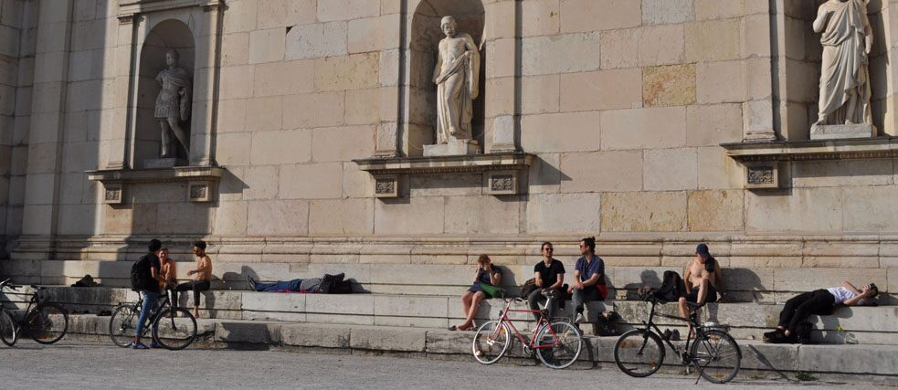 A group of people relax on Königsplatz in Munich.