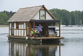 <b>Floating half-timbered house in Brandenburg</b><br>Real estate agent Harald Busse's houseboat rocks gently on the waves of Scharmützel Lake in Wendisch Rietz, Brandenburg. Busse outfitted his floating, half-timbered home with a bath, toilet, and living room and has sailed it on the waters of Brandenburg since 2010. This aquatic motorized home is officially licensed as a sports boat.