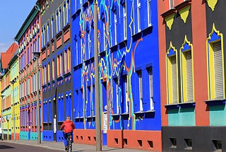 "<b>The colourful buildings of Magdeburg</b><br/>When architect Bruno Taut was appointed to the Magdeburg city planning office in 1921, he concocted a plan to liven up the city's uniform grey walls. ""The colour will restore the buildings' character"", he is reported to have said, before hiring artists to repaint the baroque town hall and entire city blocks in brilliant colours. Most of these colourful buildings were destroyed during the Second World War, so the facade designs drafted by architect and artist Carl Krayl have been reconstructed in Otto-Richter-Straße."