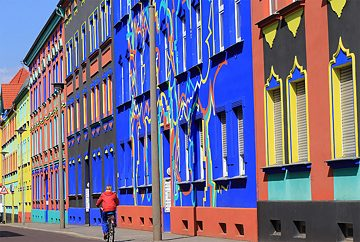 "<b>The colorful buildings of Magdeburg</b><br/>When architect Bruno Taut was appointed to the Magdeburg city planning office in 1921, he concocted a plan to liven up the city's uniform grey walls. ""The colour will restore the buildings' character"", he is reported to have said, before hiring artists to repaint the baroque town hall and entire city blocks in brilliant colours. Most of these colourful buildings were destroyed during the Second World War, so the facade designs drafted by architect and artist Carl Krayl have been reconstructed in Otto-Richter-Straße."