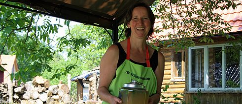 Like a refreshment? Heidi Knappe with her homemade woodruff punch