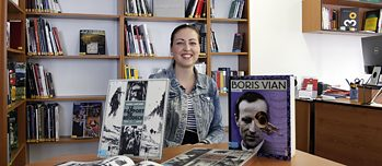 Iva enjoys French comics and graphic novels in the Romance Library.