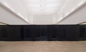 An optical illusion confronts visitors as they enter the pavilion: the wall that seems to be blocking their way is actually dozens of individual, offset panels.