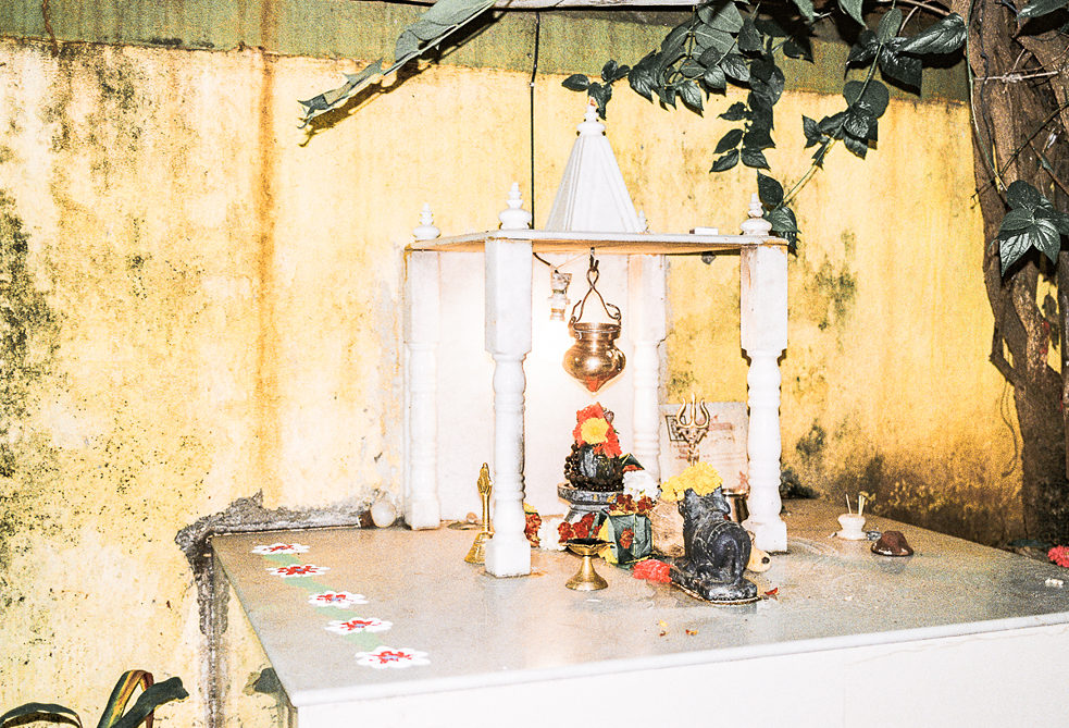 Hindu shrine with the trishul (trident) and bull, considered signs of the god Shiva