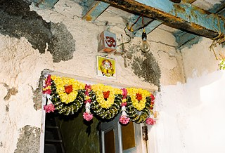 Entrance to the house of a Hindu Koli family with Ganpati, the elephant god, and the 'om' symbol above the threshold.