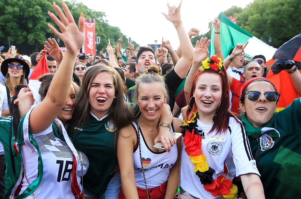 For many football fans, wearing Germany's national colours is just part of the fun and has nothing to do with xenophobia or exclusion - but criticism is growing.