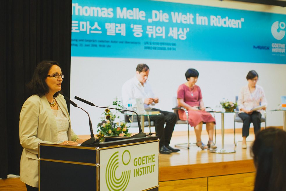 "Dr. Marla Stukenberg, Regional Director of the Goethe-Institut in East Asia, welcomed the audience and guests to a bilingual reading of ""The World at Your Back."""