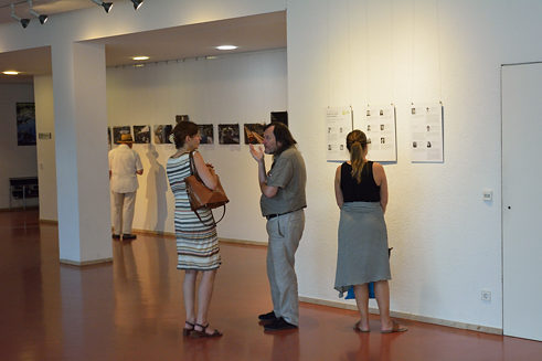 Guests discussing the images of the students.