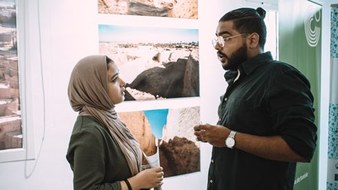 The artist Mohamed El-Bosifi talking to a visitor