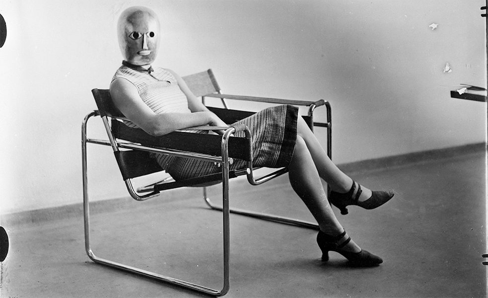 Woman sitting in Marcel Breuer tubular steel chair, 1926.