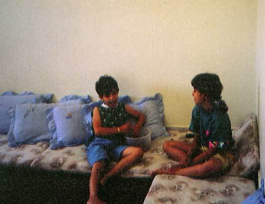 Cousin Nour (left) with the author at the grandparents' house in Gaza City, Palestine, 1989
