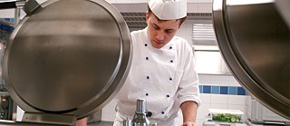 A young man training as a chef.