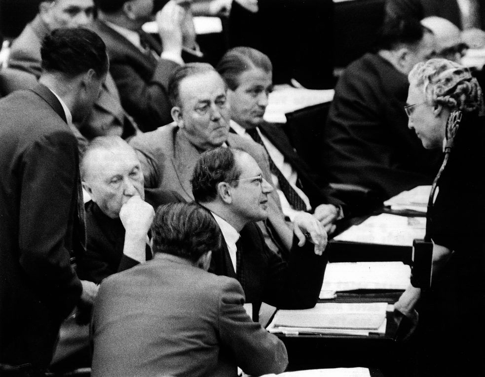 In 1956 CDU MP Helene Weber debates the national service law with German Chancellor Konrad Adenauer and other MPs in the German Bundestag.