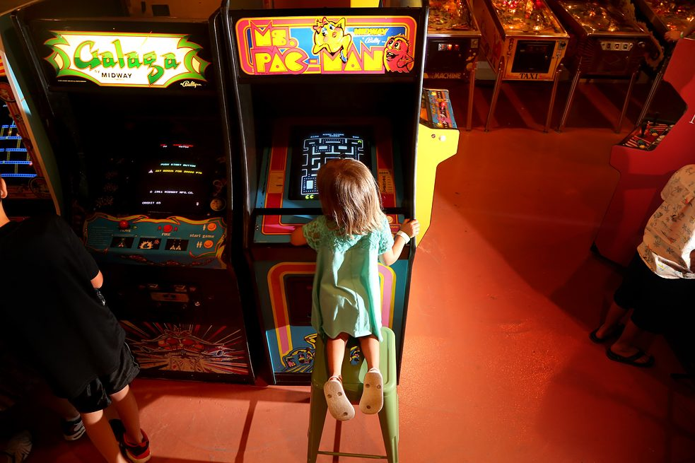 Ms. Pac-Man was the first action game heroine: a girl playing on a Ms. Pac-Man arcade machine.