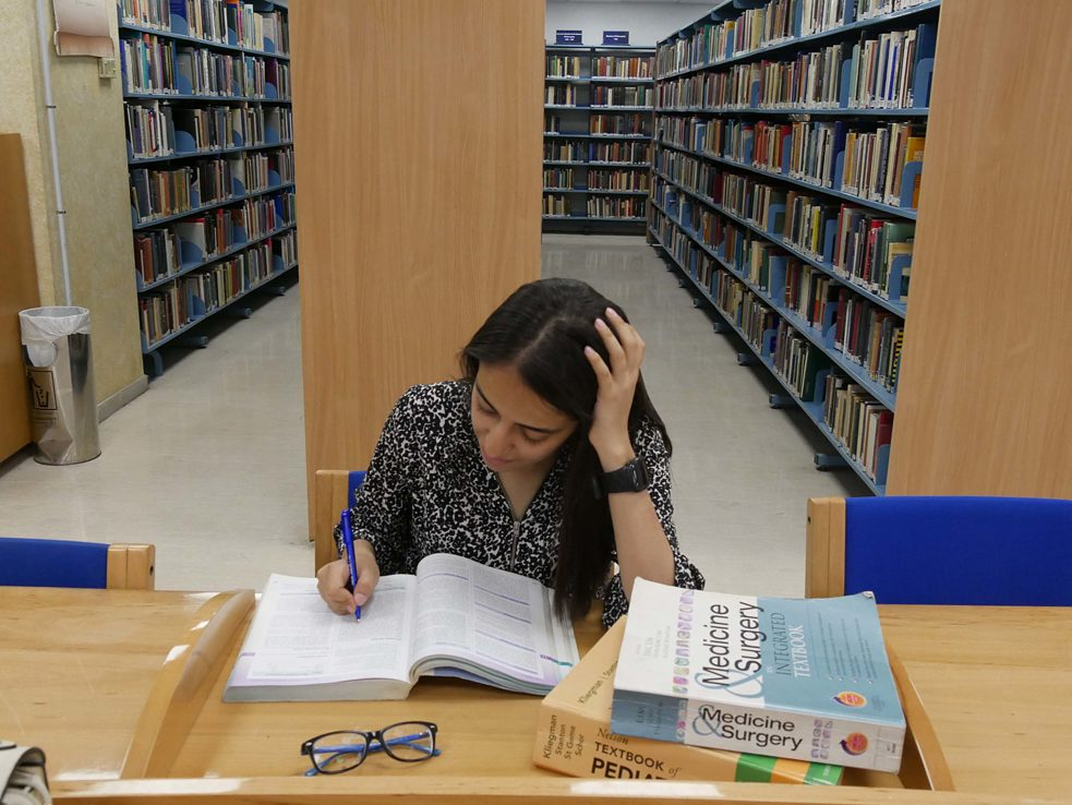 Nouf Khalifeh takes advantage of the collection for her medical degree