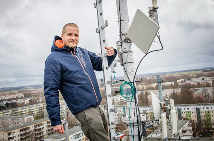 The free access activist Christian Wedell high above Rostock.
