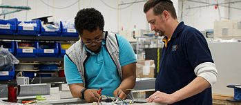 Apprentice Jahi Taylor and his mentor Erik Smith