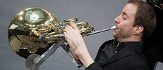 French horn player Felix Klieser was born with no arms and works the valve on his instrument with his left foot.