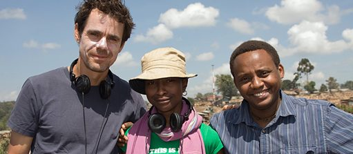 "Tykwer, Essuman and Kahora on the set of ""Soul Boy"""