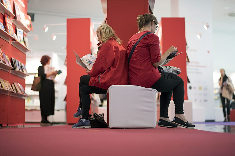Two women browse back to back at the Frankfurt Book Fair, where the German Book Prize is awarded. Women account for two thirds of the novel-reading public in Germany.
