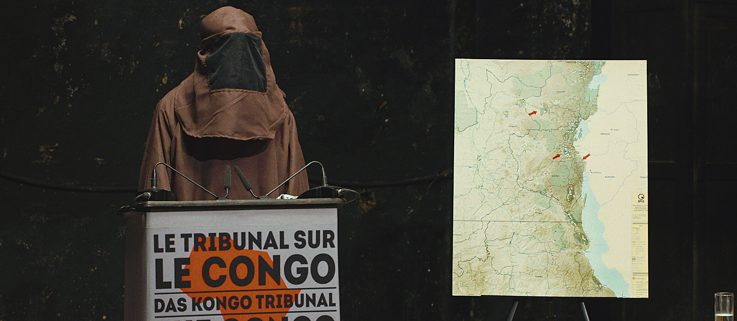 A former rebel speaks to The Congo Tribunal as an anonymous witness. Although it was an art project, the staging had a real impact.