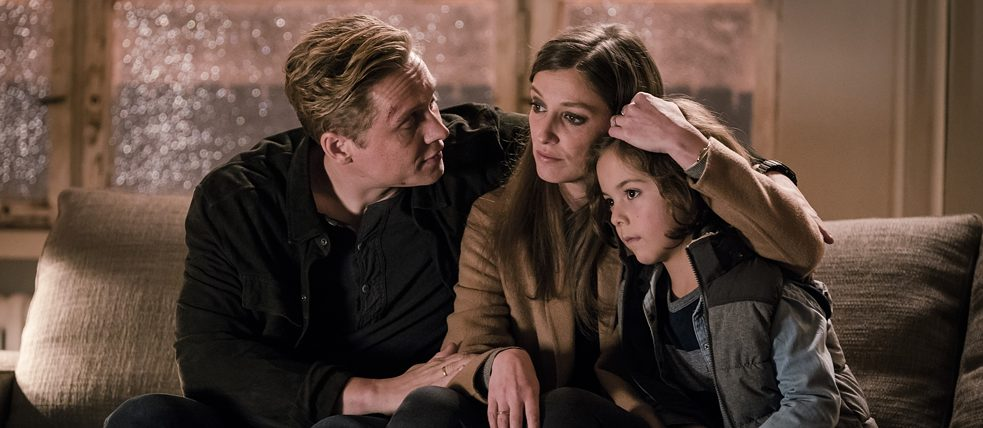 Still from You Are Wanted – Family meeting in the living room: the Franke family huddled on their sofa discussing how to leave Germany