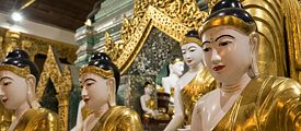 Buddha statues inside the Shwedagon Pagoda in the Myanmari metropolis of Yangon
