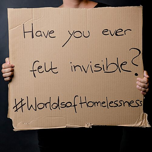Worlds Of Homelessness photo of a card board sign asking if have you ever felt invisible