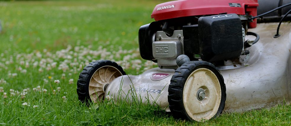 Lawn mower on a lawn surface
