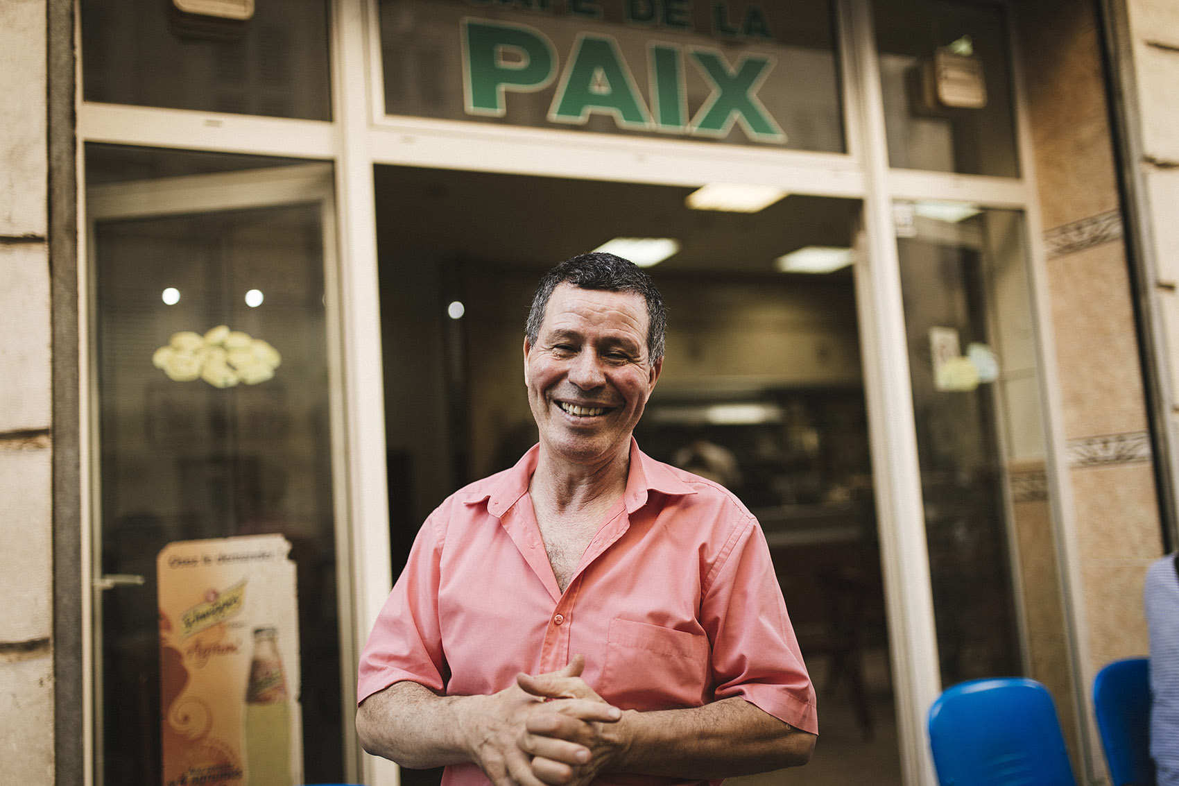 """You're free when you live in peace,"" he says, ""in harmony with those around you."" Hence the name of his establishment, Café de la Paix, right across from his olive tree, an enduring symbol of peace."