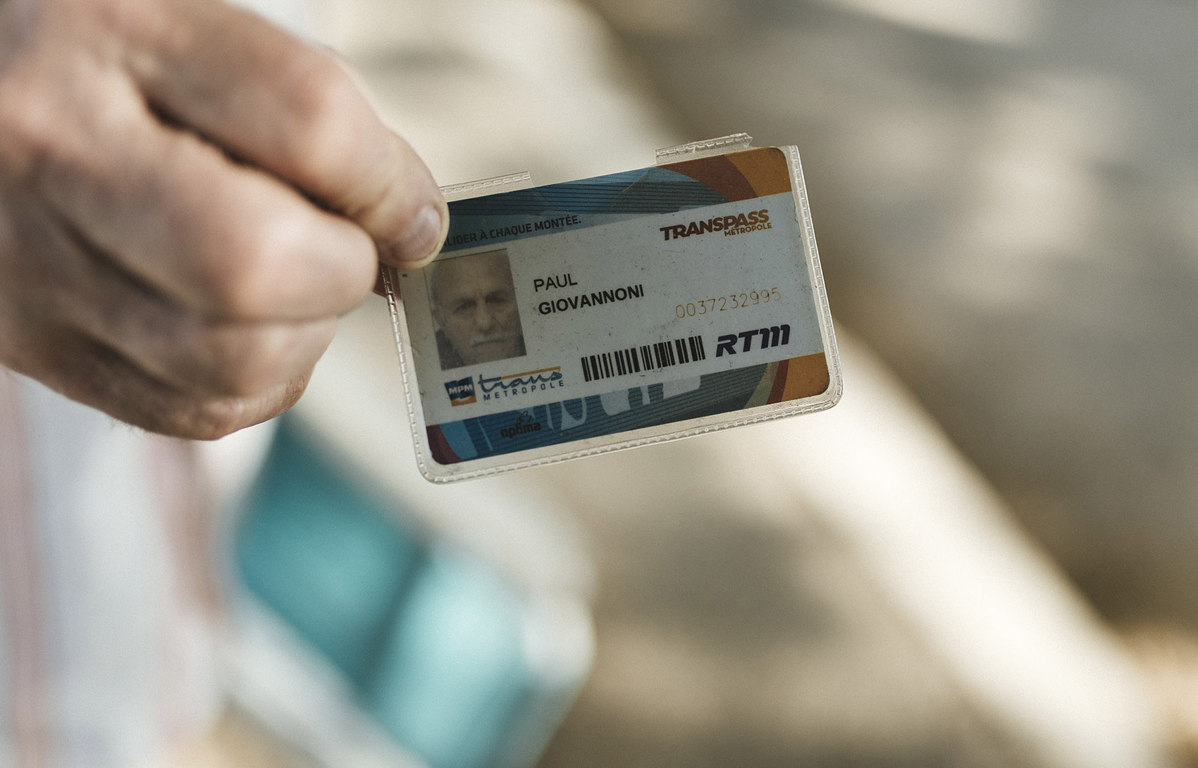 Paul Giovanonni shows his Transpass Métropole, a public transport ticket in Marseille