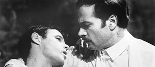 "Scene from the movie ""Querelle"" with Brad Davis (left) and Franco Nero"