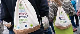 "Cotton and cork drawstring bags with the slogan ""Eat. Sleep. Reuse. Reduce. Recycle. Repeat"""