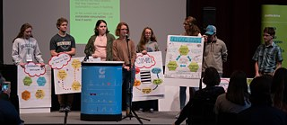 "Students presenting their ideas after the workshop ""Sustainable consumption"""