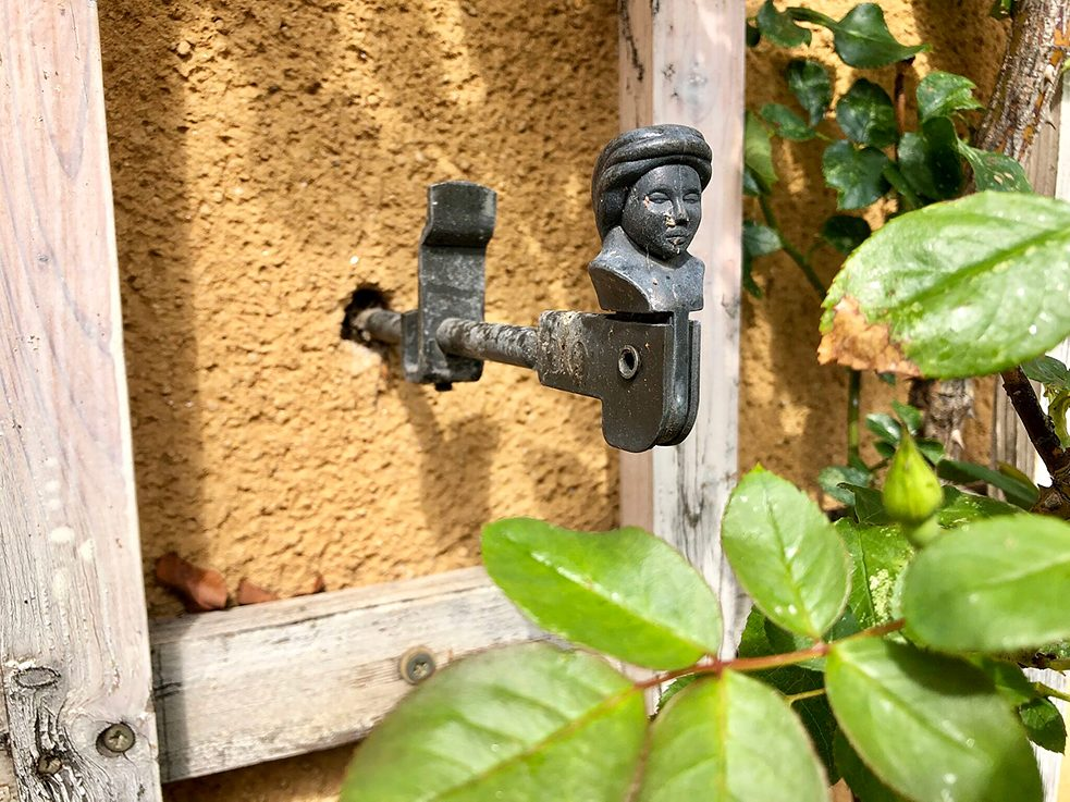 The Garden City was meticulously designed down to the smallest of details, like the decorative shutter dog pictured here.
