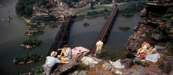 People picnic on the rocky heights that overlook Harpers Ferry in Maryland, 1962