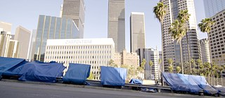 Tarps tightened in between a fence and a guard rail in Los Angeles