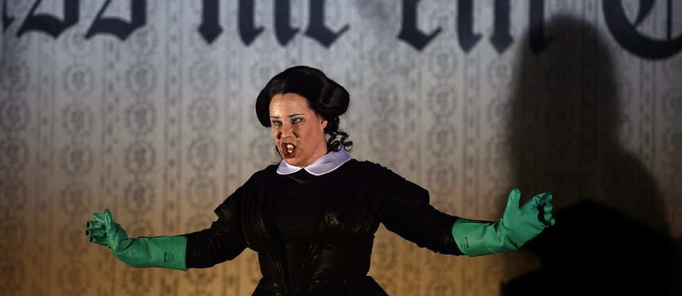 "Lucia Lucas in ""Hoffmanns Erzählungen"" at Theater Wuppertal, where they sang the role of all four villains: Lindorf, Coppelius, Doktor Mirakel and Dapertutto"