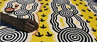 Australian Aboriginal artist Turkey Tolson Tjupurrula at work.